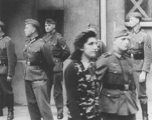 Simone Schloss, a Jewish member of the French resistance, under guard after a German military tribunal in Paris sentenced her to