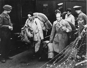 "Jewish refugees, forcibly removed by British soldiers from the ship ""Exodus 1947,"" arrive at Poppendorf displaced persons camp. Photograph taken by Henry Ries. Germany, September 8, 1947."