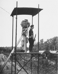 "A British guard in a watchtower at Poppendorf displaced persons camp, after the arrival of Jewish refugees forced from the ""Exodus 1947"" refugee ship. Photograph taken by Henry Ries. Germany, September 1947."