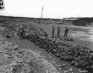 US troops view bodies of victims of Kaufering IV, a Dachau subcamp in the Landsberg-Kaufering area.