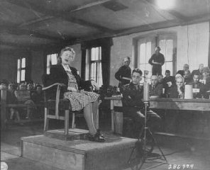 Ilse Koch testifies in her own defense at the trial...