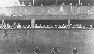 "Refugees aboard the ""St. Louis"" wait to hear whether Cuba will grant them entry. Off the coast of Havana, Cuba, June 3, 1939."