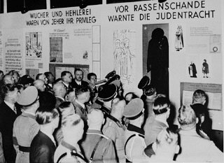 "Nazi officials attend the opening of ""Der ewige Jude"" (The Eternal Jew), an antisemitic exhibition in Munich."