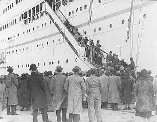 "After the Anschluss (German annexation of Austria), Austrian Jewish refugees  disembark from the Italian steamship ""Conte Verde."