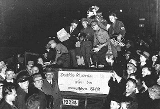 "Students and members of the SA unload books deemed ""un-German"" during the book burning in Berlin."