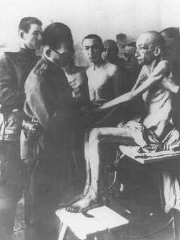 Soon after liberation, a Soviet physician examines Auschwitz camp survivors.