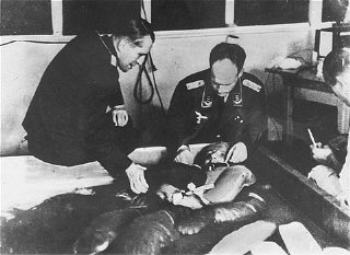 Victim of Nazi medical experiment immersed in freezing water at Dachau concentration camp.