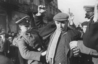 SS men search Jews for weapons. Warsaw, Poland, October...