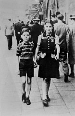 Jewish children wearing the compulsory yellow badge...