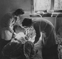 Soon after liberation, a camp survivor receives medical...