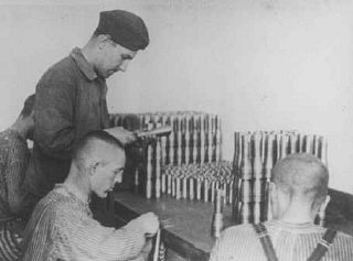 Prisoners work in an armaments factory.