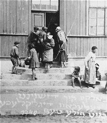 Women and children at the door of a soup kitchen maintained...