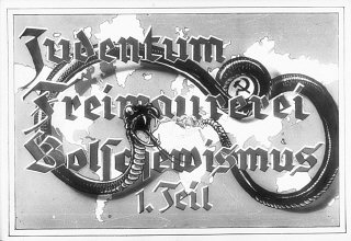 "Propaganda slide entitled ""Jewry, Freemasonry and Bolshevism,"" featuring a poisonous snake with bared fangs. This served as the title slide for Part I of a lecture series produced by ""Der Reichsfuehrer SS, der Chef des Rasse-und Siedlungshauptamtes"" (the Leader of the SS, the Chief of the Race and Settlement Main Office), ca. 1936."