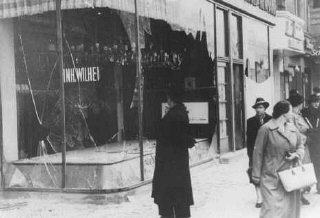 "Jewish-owned shop destroyed during Kristallnacht (the ""Night of Broken Glass"")."