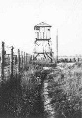 View of watchtower and fence at the Majdanek camp...