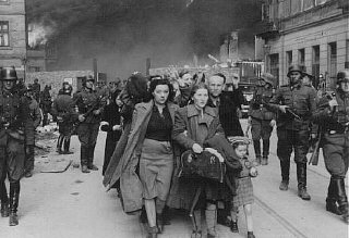 German soldiers lead Jews captured during the Warsaw...