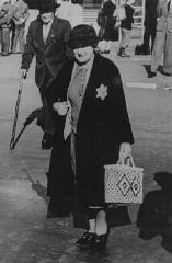 An elderly German Jewish woman wearing the compulsory Jewish badge.