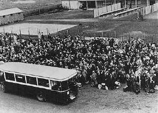 Jews arrive at the Drancy transit camp by bus.