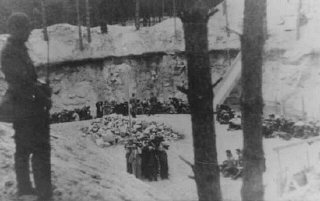 Lithuanian collaborators guard Jews before their execution.