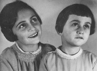 Margot and Anne Frank before their family fled to the...
