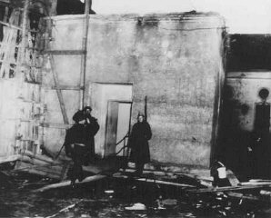 Soviet soldiers guard the entrance to Hitler's underground...