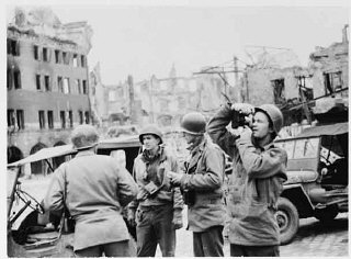 US Army Signal Corps photographers from Combat Unit...