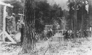 Execution of prisoners, most of them Jewish, in the forest near Buchenwald concentration camp. Germany, 1942 or 1943.