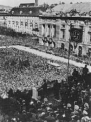 Hitler addresses a jubilant crowd on Vienna's Heldenplatz after Germany annexed Austria (the Anschluss). Austria, March 15, 1938.