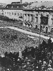 Hitler addresses a jubilant crowd on Vienna's Heldenplatz...