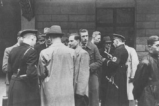 SS and Nazi police prepare for a raid on the Jewish community offices in Vienna.
