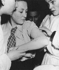 A former concentration camp prisoner receives care...