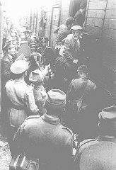 Police force Romanian Jews, survivors of a pogrom in Iasi, to board a train during their expulsion from Iasi to Calarasi.