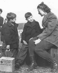 Jewish refugee children from Budapest talk to a worker...