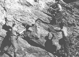 Jewish forced laborers in the quarry of a forced-labor...