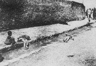 Armenian children lie in the street of an unidentified...