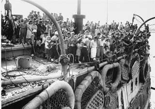 "Passengers on the deck of the refugee ship ""Exodus..."