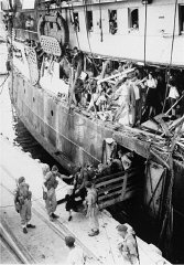Jewish refugees, including children, disembark from...