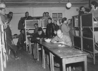 Jewish refugees in the barracks at Feldafing displaced persons camp. Germany, after May 1945.