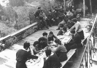 An art class for children in the Fiesole displaced persons camp, outside Florence. Italy, 1946.