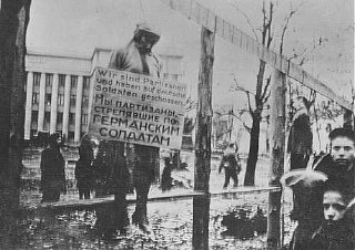 "A hanged Jewish partisan with a sign stating, ""We..."