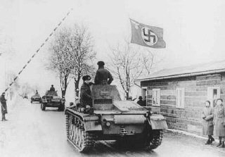 German tanks cross the Czech border, in violation of the 1938 Munich agreement. Pohorelice, Czechoslovakia, March 15, 1939.