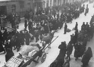 Jews deported from Germany and Austria march towards...