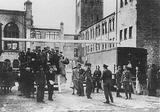 Jews from the Riga ghetto arrive at their forced-labor...