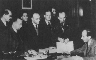 Raoul Wallenberg (seated) at the Swedish legation...