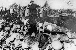 Corpses of inmates discovered by Soviet troops at the Klooga forced-labor camp. Nazi guards and Estonian collaborators had executed the prisoners and then stacked the bodies for burning. Estonia, September 1944.