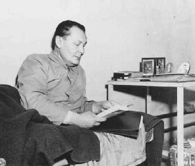 Defendant Herman Goering reads in his prison bunk at Nuremberg.