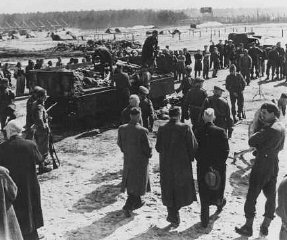 After liberation of the Bergen-Belsen camp, British soldiers forced German mayors from nearby towns to view mass graves. Bergen-Belsen, Germany, after April 15, 1945.
