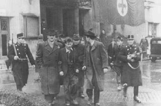 Members of the fascist Arrow Cross Party arrest Jew...