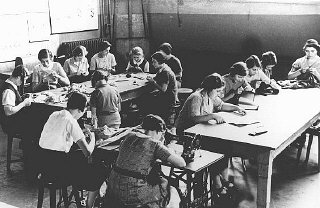 Girls in a sewing class at the Adas Israel school...