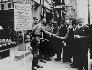 SA men distribute leaflets during the anti-Jewish b...